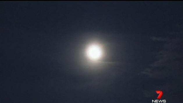 Supermoon hidden by thick cloud