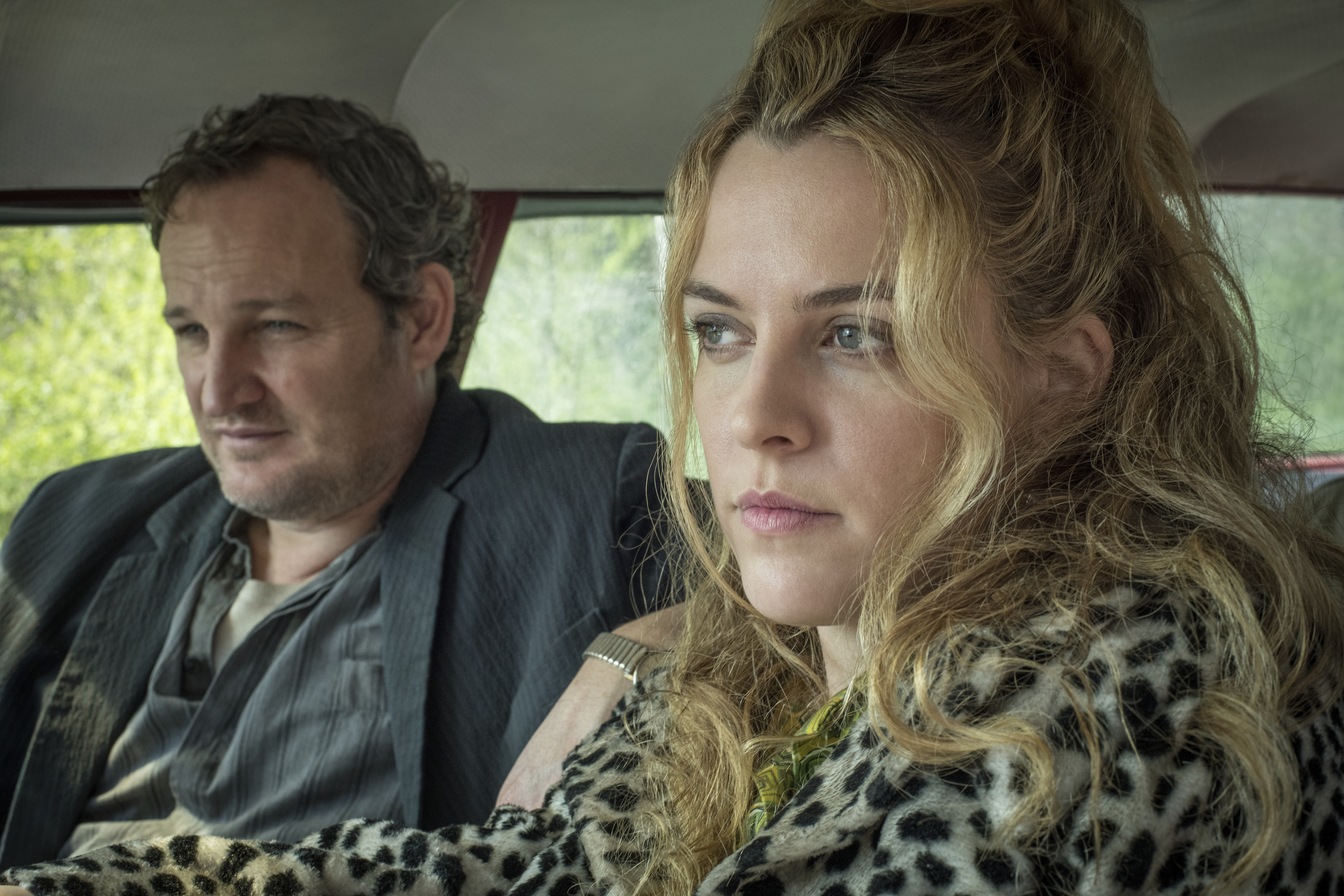 """This image released by Netflix shows Jason Clarke, left, and Riley Keough in a scene from """"The Devil All The Time."""" (Glen Wilson/Netflix via AP)"""