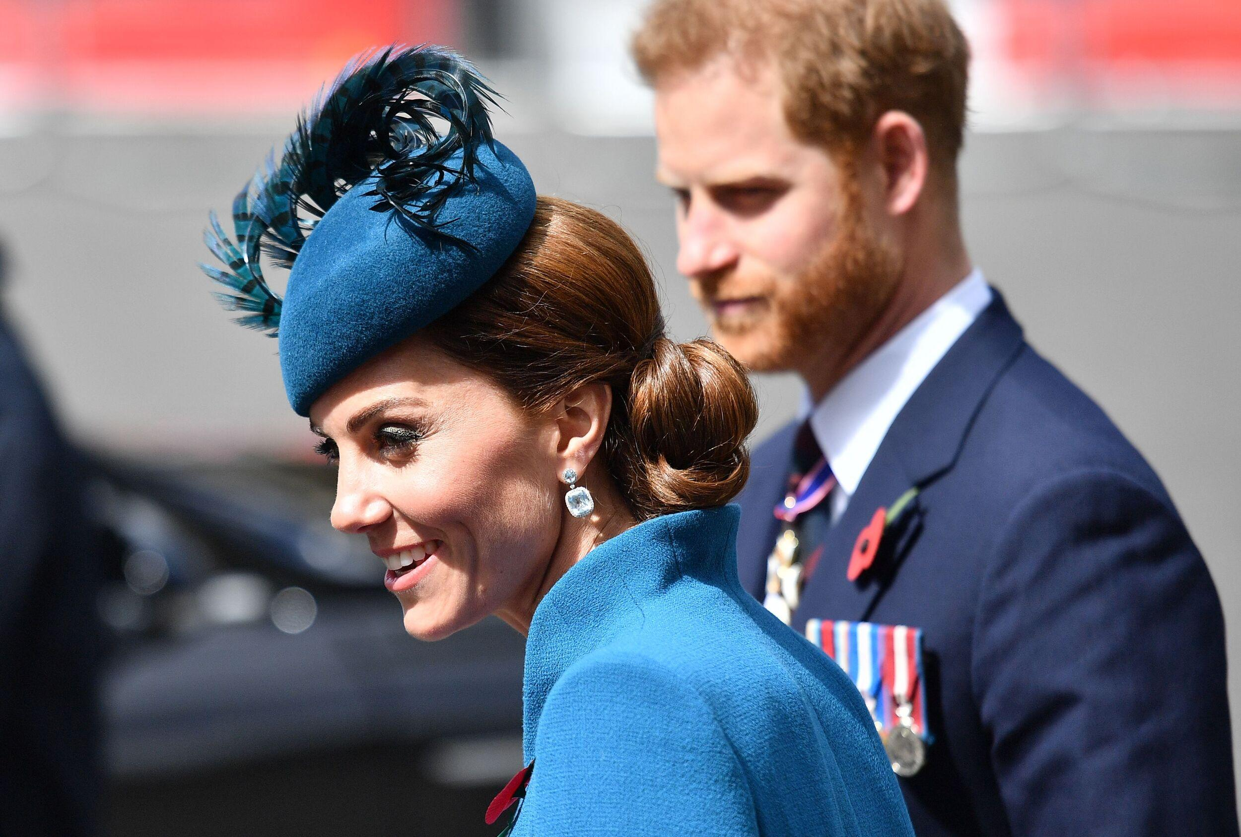 Britain's Catherine, Duchess of Cambridge (L) and Britain's Prince Harry, Duke of Sussex leave after attending a service of commemoration and thanksgiving to mark Anzac Day in Westminster Abbey in London on April 25, 2019. - Anzac Day marks the anniversary of the first major military action fought by Australian and New Zealand forces during the First World War. The Australian and New Zealand Army Corps (ANZAC) landed at Gallipoli in Turkey during World War I. (Photo by Daniel LEAL-OLIVAS / AFP)        (Photo credit should read DANIEL LEAL-OLIVAS/AFP/Getty Images)