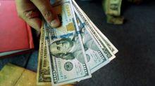 Dollar falls against yen, Swiss franc on new trade concerns
