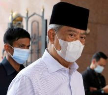 Malaysia's Muhyiddin urges lawmakers to pass budget to tackle COVID-19