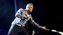 Morrissey fan accused of punching singer after jumping on stage says 'it looked bad but I just wanted to hug him'
