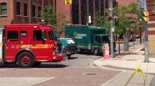 Underground explosion blows manhole cover into the air downtown