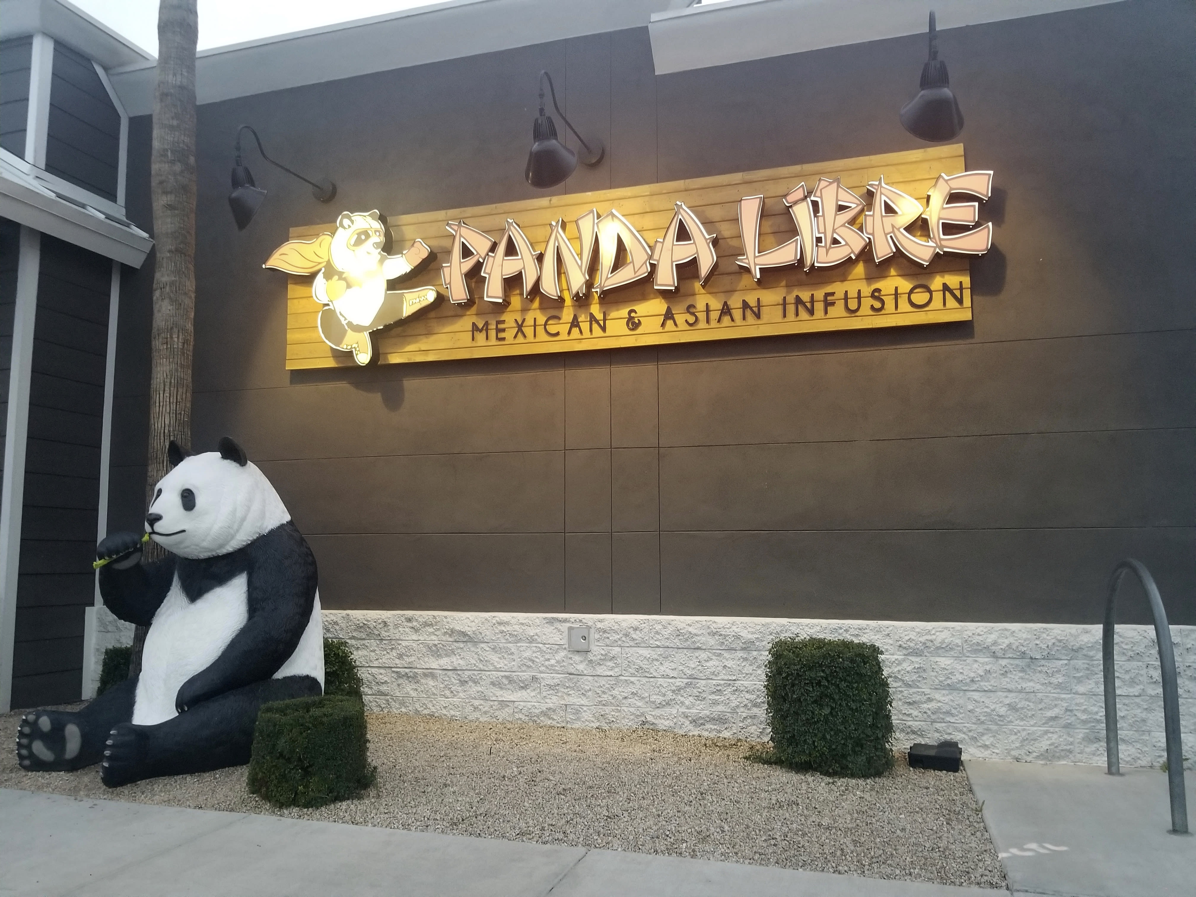 """Panda Libre, an Asian-Mexican fusion restaurant, in Gilbert, Ariz., is pictured on Thursday, Feb. 27, 2020. When picking a name for their Asian-Mexican fusion restaurant in suburban Phoenix, Paul and Nicole Fan settled on """"Panda Libre,"""" hoping the mix of China's iconic bear and the Spanish word for """"free"""" would signal to customers the type of cuisine it offered. That decision could cost them dearly. Chinese takeout chain Panda Express sued them in federal court last month alleging trademark infringement. (AP Photo/Terry Tang)"""