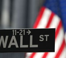 Stocks Close Lower as Global Covid Cases Hit New Highs