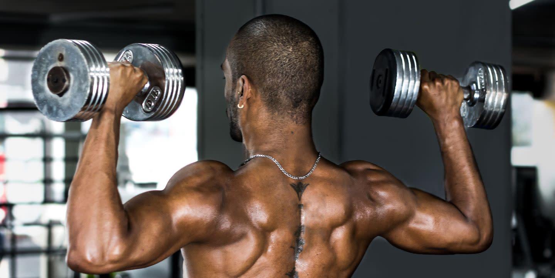This Dumbbell Workout Can Safely Build Boulder Shoulders