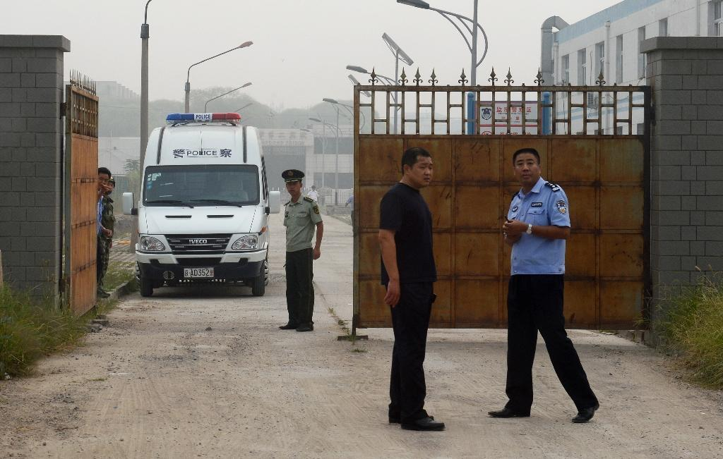 Chinese police stand guard outside Number Two Prison in Beijing, where US geologist Feng Xue was held for seven years after being convicted on state secrets charges