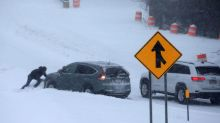 Flight cancellations persist as storm weakens in U.S. Northeast
