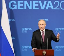 Putin dodges question about Russian dissidents by pointing to U.S. unrest