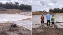 'Like a cloud burst': Family rejoices after rainfall fills 'bone dry' dam in one hour