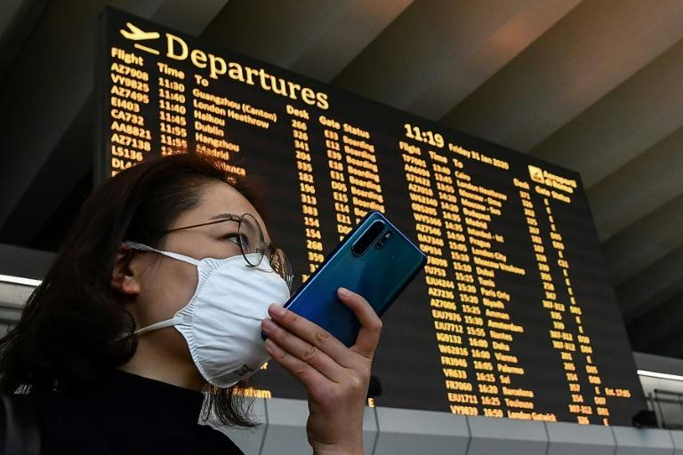 The coronavirus pandemic has led to the creation of apps and tracking systems using people's smartphone location as part of the effort to limit contagion (AFP Photo/Tiziana FABI )