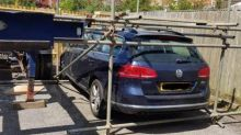 Neighbour traps car in scaffolding cage during bizarre parking row