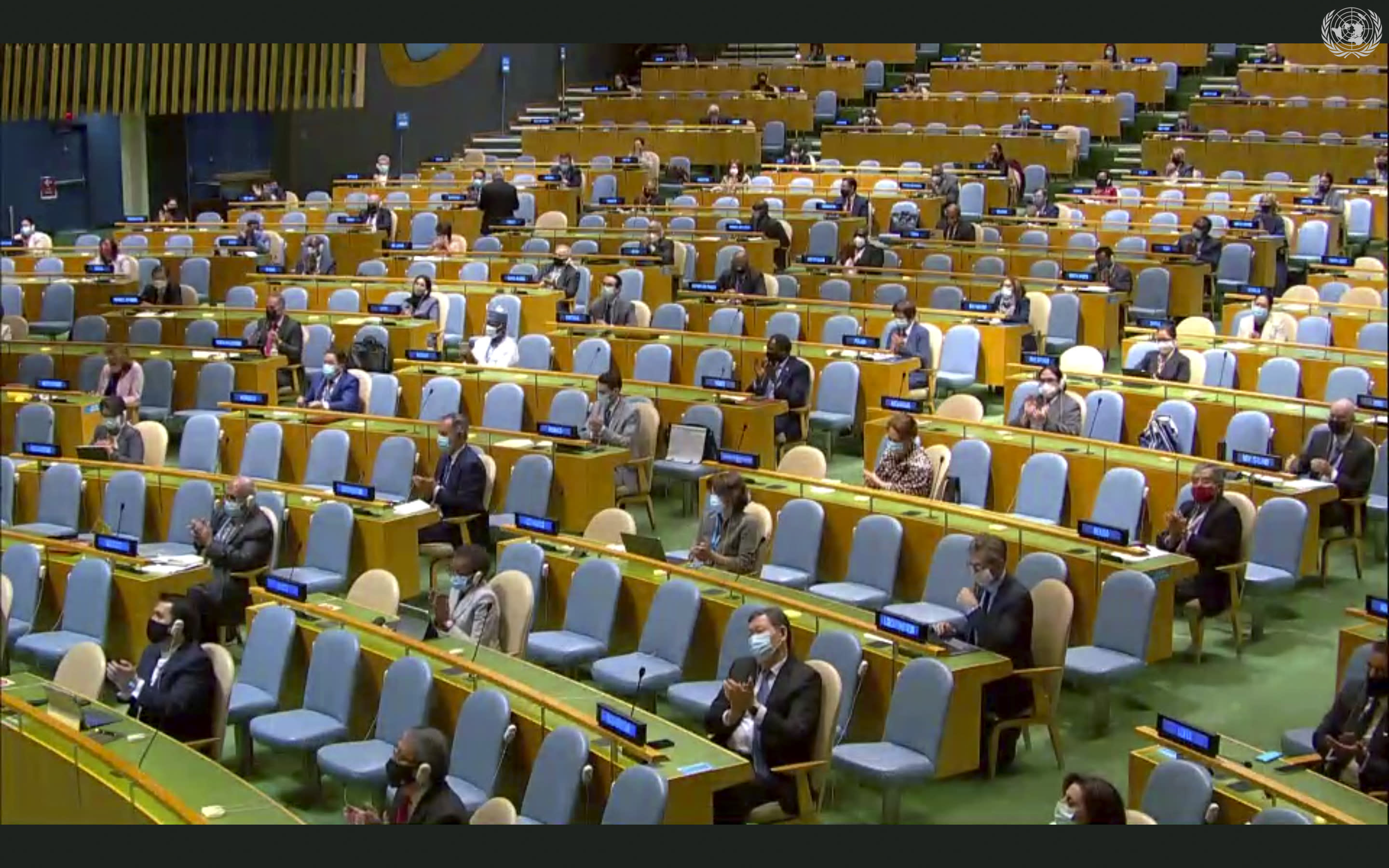 In this image made from UNTV video, people applaud after a pre-recorded message was played during the 75th session of the United Nations General Assembly, Tuesday, Sept. 22, 2020, at U.N. headquarters in New York. The U.N.'s first virtual meeting of world leaders started Tuesday with pre-recorded speeches from some of the planet's biggest powers, kept at home by the coronavirus pandemic that will likely be a dominant theme at their video gathering this year. (UNTV via AP)