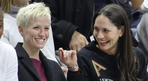 WNBA legend Sue Bird (right) and U.S. women's soccer star Megan Rapinoe share a laugh. (AP)