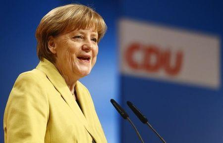 German Chancellor and CDU leader Merkel smiles while addressing the party convention in Cologne