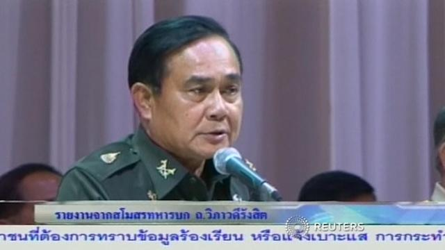 Ousted Thai PM answers general's summons a day after coup