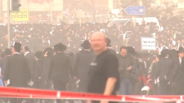 Ultra-Orthodox Jews protest at the entrance to Jerusalem