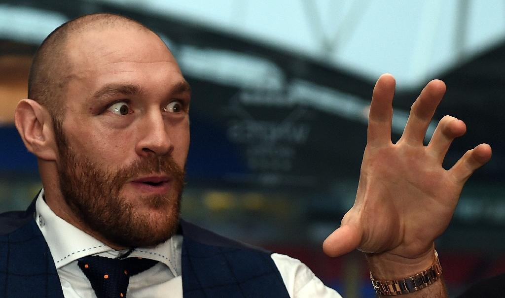 Britain's world heavyweight champion Tyson Fury speaks during a press conference in Bolton, in November 2015