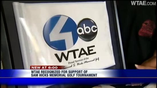 Family of Sam Hicks presents WTAE with golf flag from memorial tournament