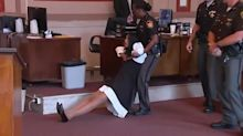In chaotic scene, ex-judge dragged from Cincinnati courtroom, sentenced to jail
