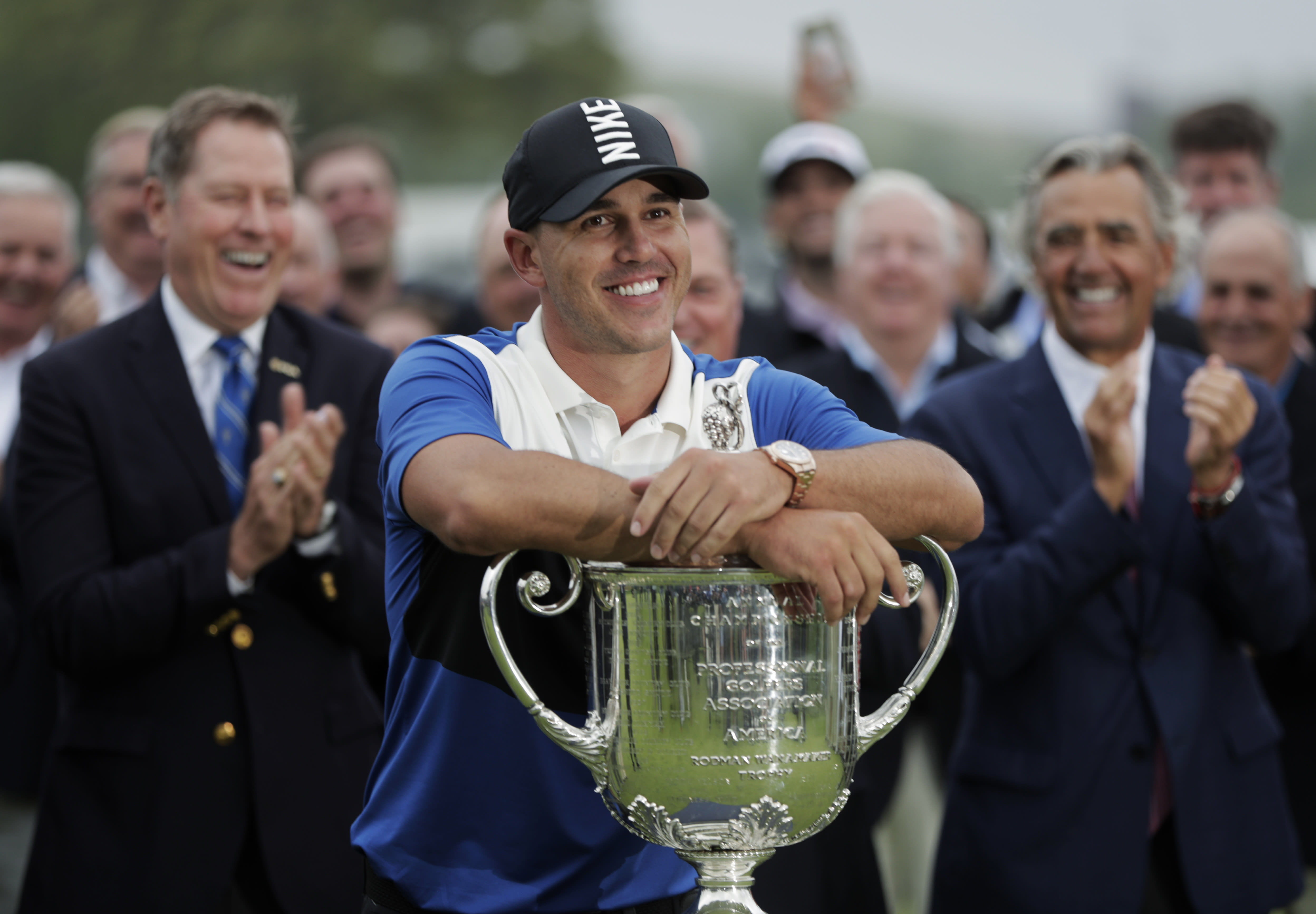 FILE - In this May 19, 2019, file photo, Brooks Koepka poses with the Wanamaker Trophy after winning the PGA Championship golf tournament at Bethpage Black in Farmingdale, N.Y. Koepka will try to become the first player to win the PGA Championship three straight times in stroke play starting Aug. 6, 2020, and there will not be anyone at Harding Park to cheer him on. (AP Photo/Julio Cortez, FIle)