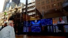 Australian stocks retreat from record high