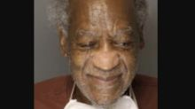 Bill Cosby's new mug shot shows him smiling, with unkempt hair