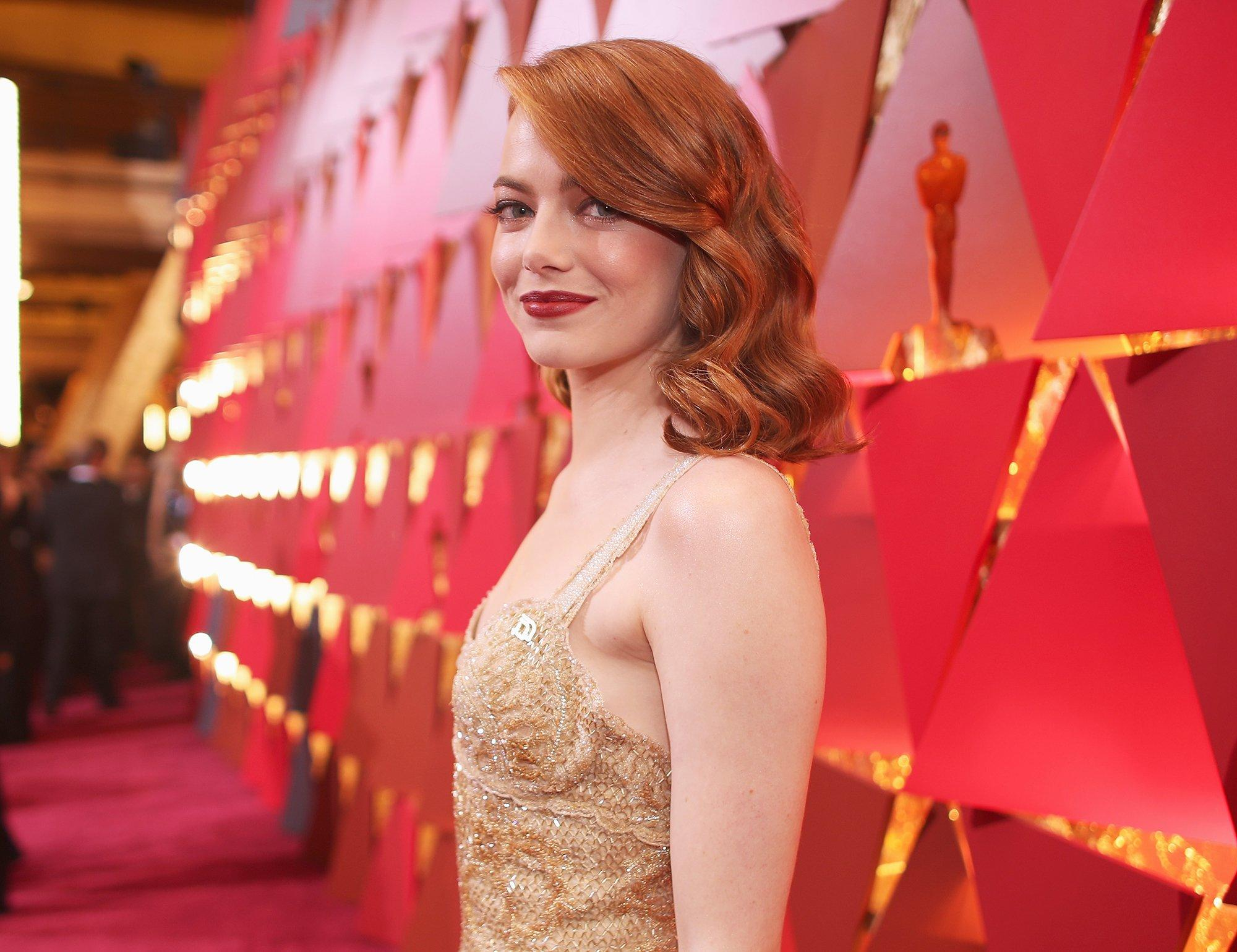 emma stone made a political statement with her accessories before the oscars even began