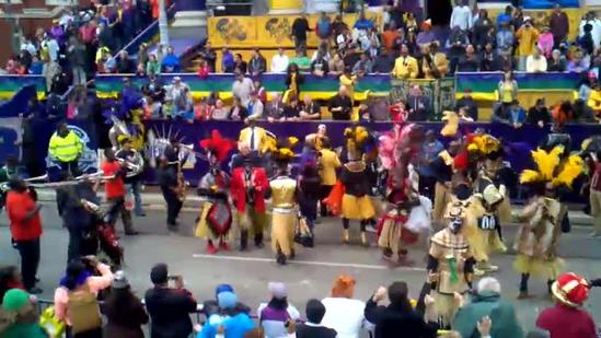 Zulu tramps dance in the street Mardi Gras morning