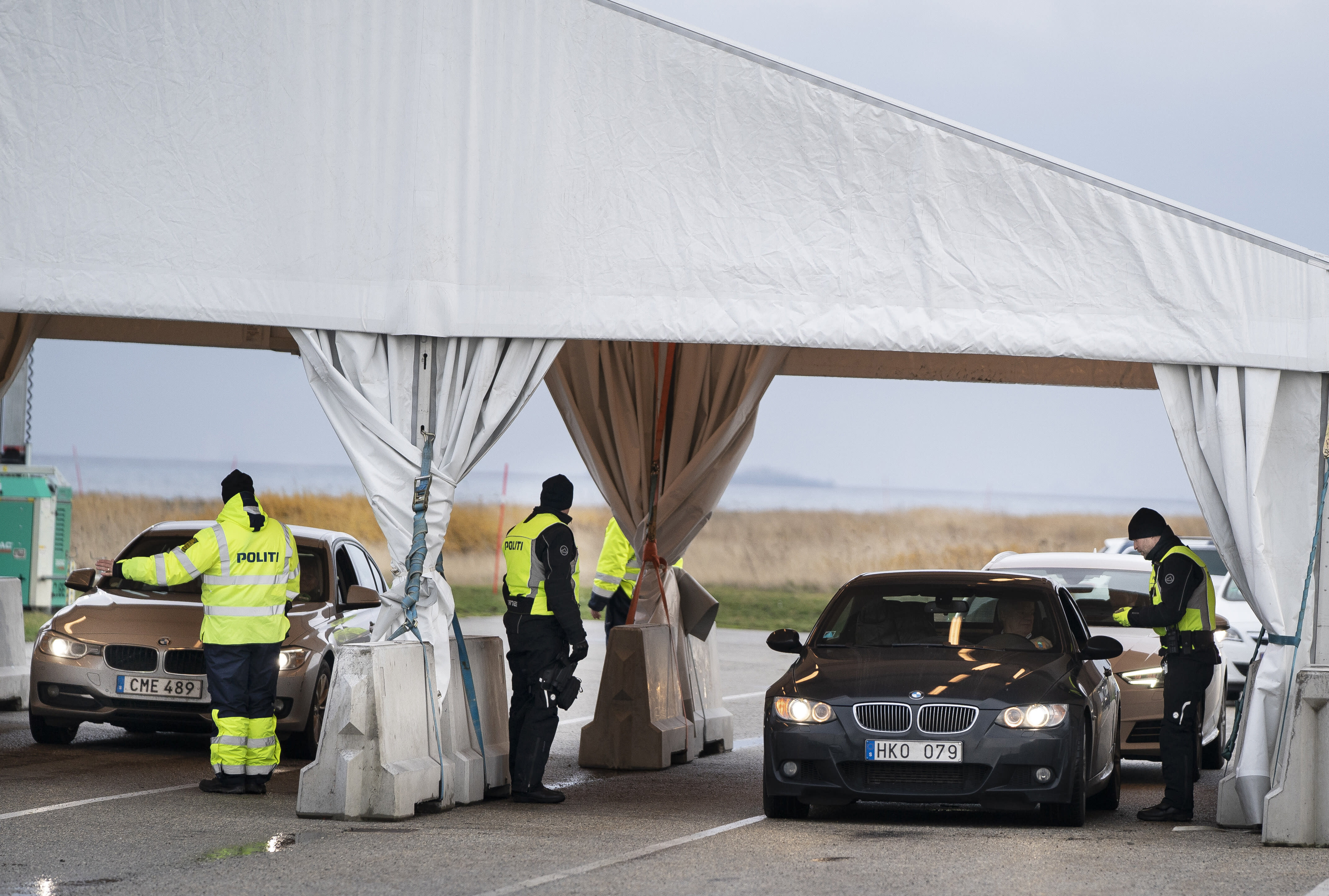 Danish police check travellers from Sweden, near the Highway coming out of the Tunnel near Copenhagen, Denmark, Tuesday Nov. 12, 2019. Danish police have begun to carry out border checks at its crossings with Sweden after a series of shooting crimes and explosions around Copenhagen that Danes say were carried out by perpetrators from the next-door neighbour. (Liselotte Sabroe/Ritzau Scanpix via AP)
