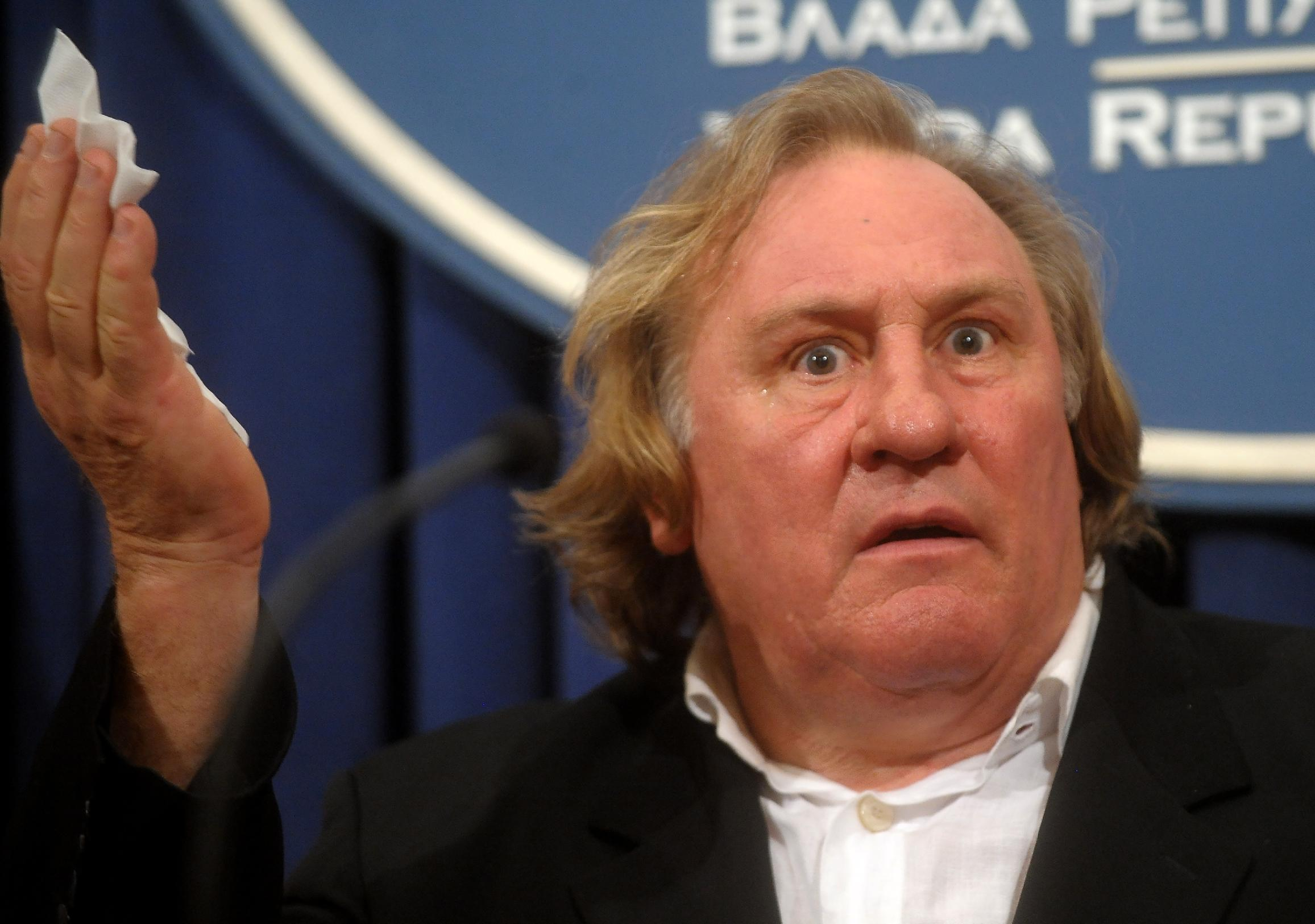 Russian citizen and actor Gerard Depardieu reacts during a press conference after talks with Serbian Prime Minister Aleksandar Vucic in Belgrade on September 4, 2014 (AFP Photo/Alexa Stankovic)
