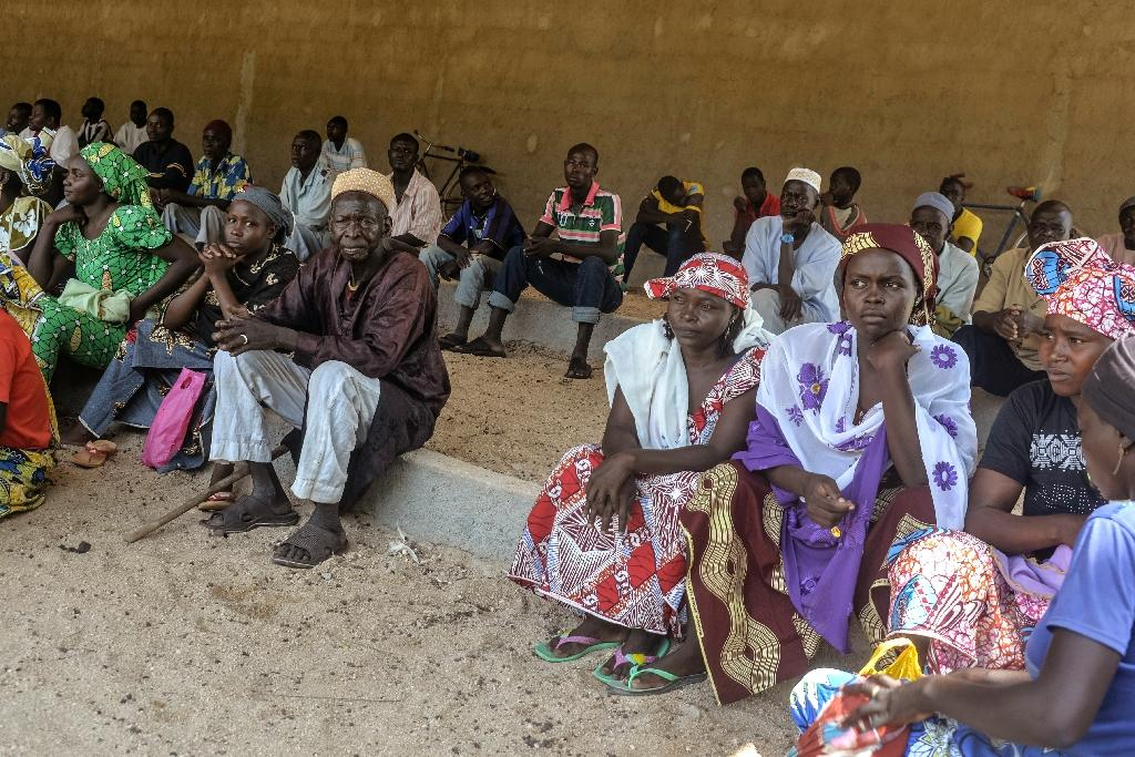 Cameroonian displaced people wait for food parcels at a food distribution center in Koza, in the extreme northern province, west of the Nigerian border, on September 14, 2016 (AFP Photo/Reinnier Kaze)