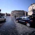 Police boost virus controls as Italians make bid for freedom