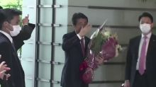 Cheers and flowers as Abe leaves office
