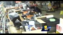 Raw Video: Armed men rob Laurel liquor store
