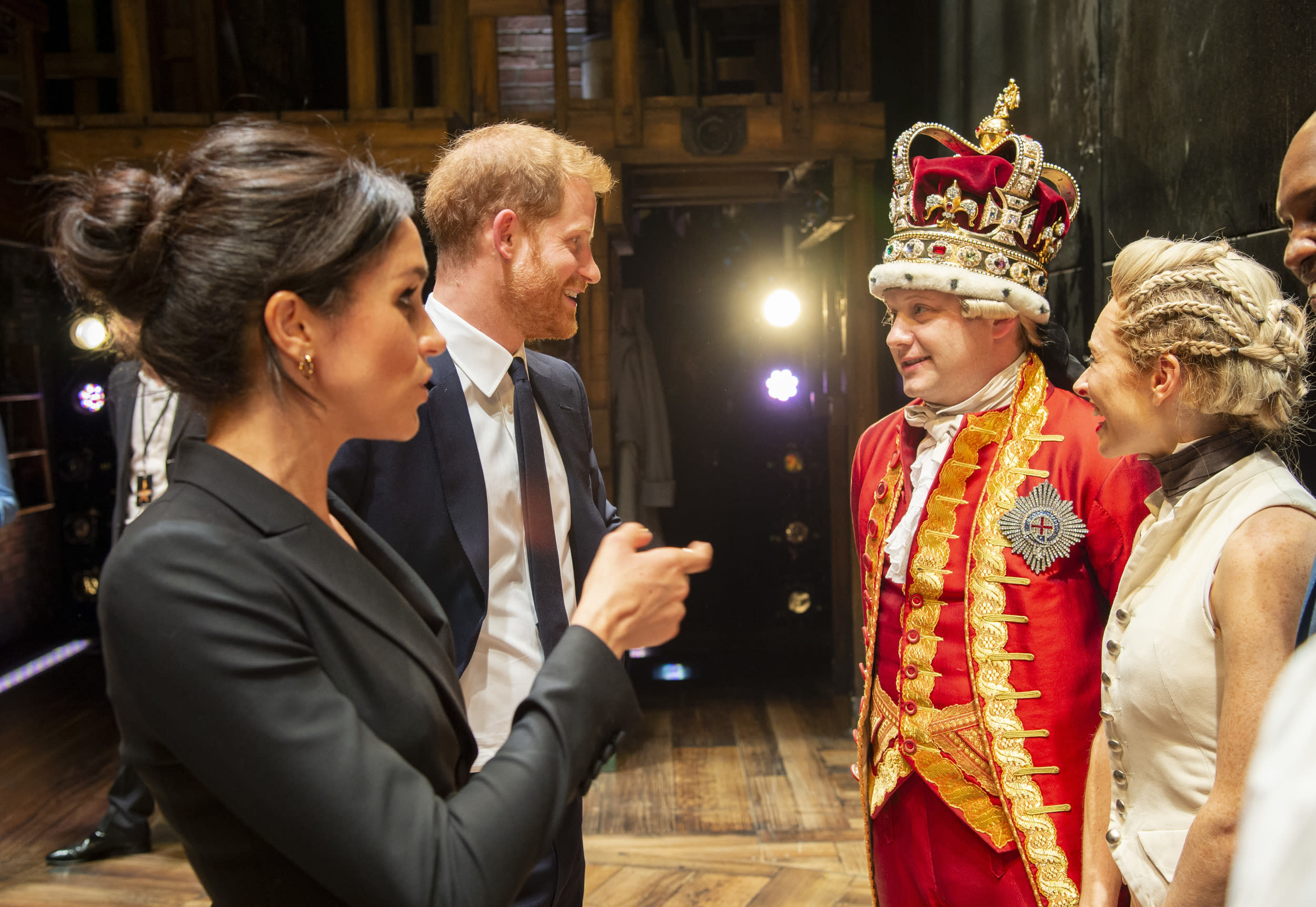 The Duke and Duchess of Sussex meeting 'King George' and the cast at the Victoria Palace Theatre in London after attending a gala performance of the musical Hamilton, in support of Sentebale.