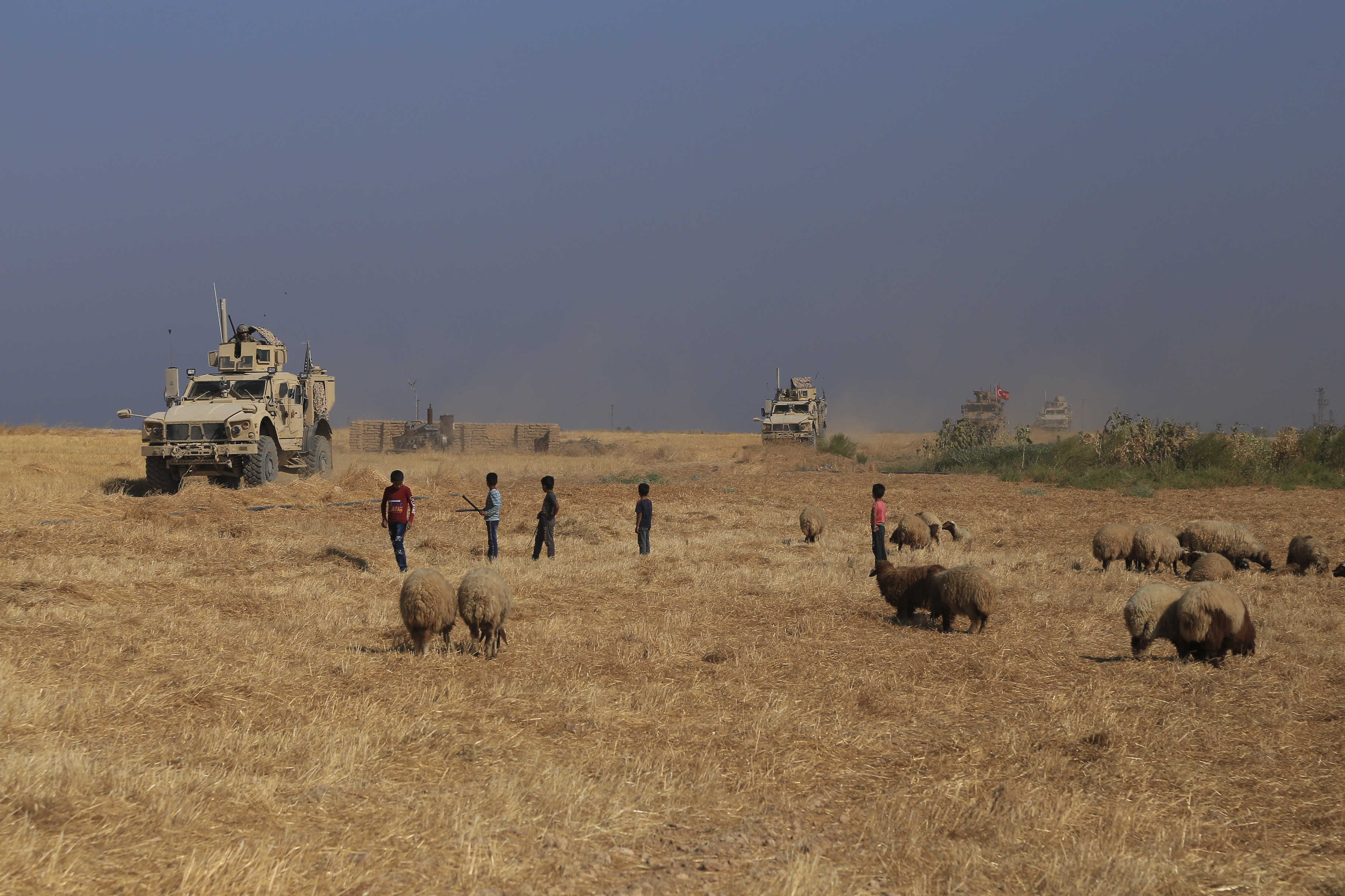 """A Turkish armored vehicle patrols with American forces, as they conduct their second joint ground patrol in the so-called """"safe zone"""" on the Syrian side of the border with Turkey, in Rahaf village, near the town of Tal Abyad, northeastern Syria, Tuesday, Sept. 24, 2019. The patrols are part of a deal reached between Turkey and the United States to ease tensions between the allies over the presence of U.S.-backed Syrian Kurdish fighters in the area. (AP Photo/Baderkhan Ahmad)"""