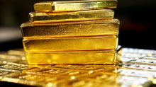 Gold prices slip as dollar firms ahead of Fed rate decision