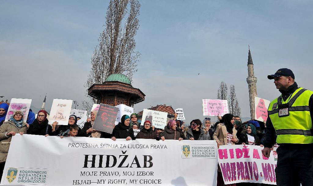Hundreds of Muslim women wearing the traditional Muslim headscarf also known as hijab protest in Sarajevo's historical centre on February 7, 2016 against a ban on the headscarf in the country's judicial institutions