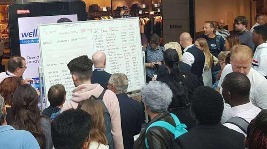Chaos at airport as staff handwrite flight info