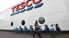 Britain's Tesco pledges to end all-white board