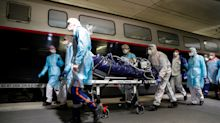 Coronavirus: Shocking pictures show patients wheeled on to trains in Paris as hospitals are overwhelmed