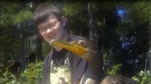 Young man rescues orphaned bird, touching friendship ensues