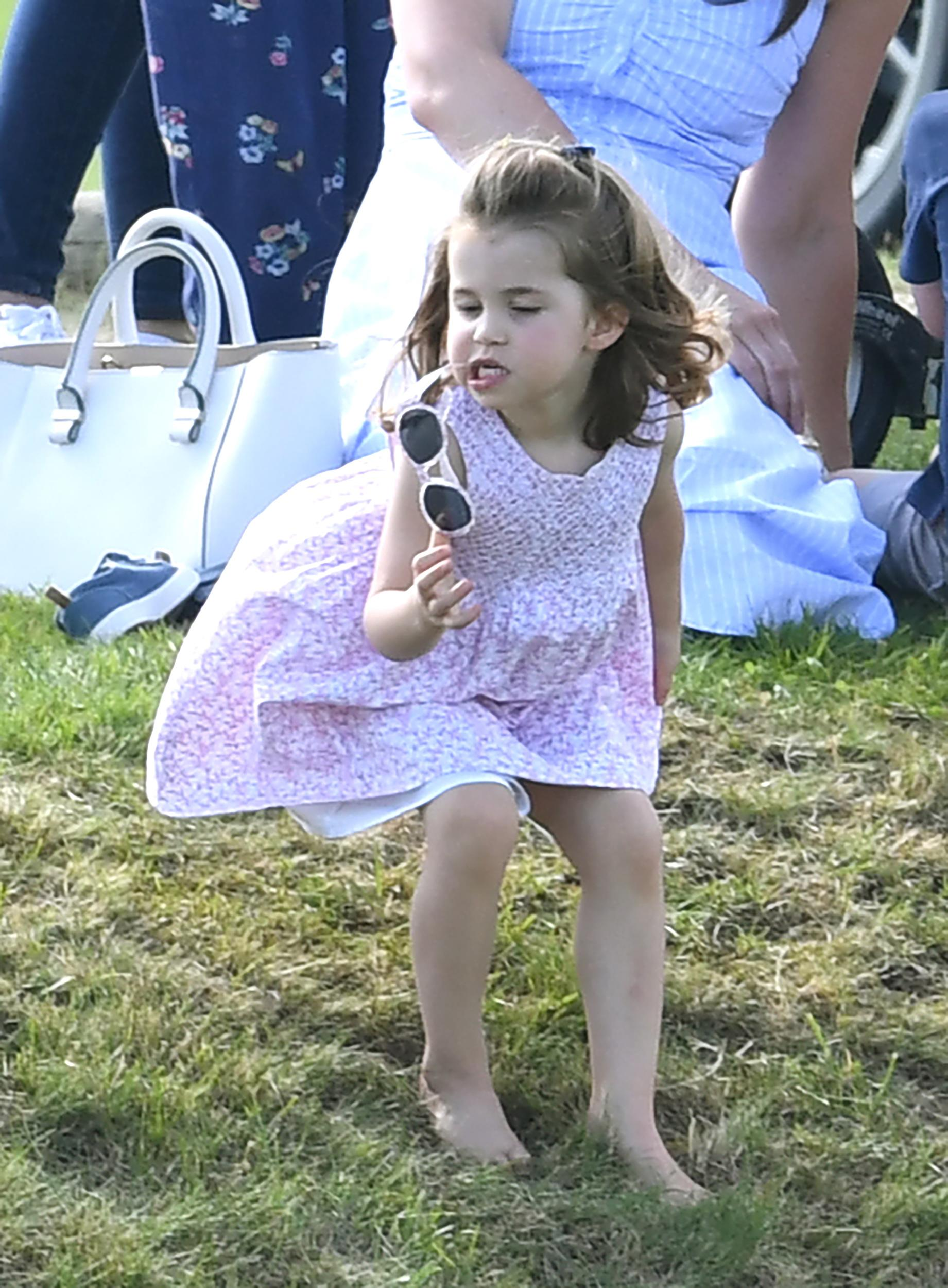 Princess Charlotte watches on as Prince William Duke of Cambridge plays Polo at the Gloucestershire Festival of Polo, the Beaufort Club, . Photo credit should read: Doug Peters/EMPICS
