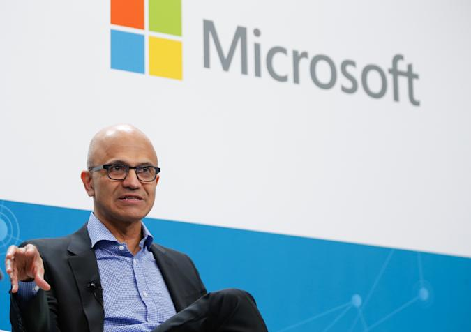 BERLIN, GERMANY - FEBRUARY 27: CEO of Microsoft Satya Nadella and CEO of Volkswagen, Herbert Diess (not seen) attend a session during their visit to Volkswagen Digital Lab in Berlin, Germany on February 27, 2019. (Photo by Abdulhamid Hosbas/Anadolu Agency/Getty Images)