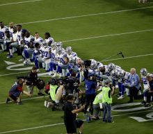 Cowboys take a knee as a team before the national anthem