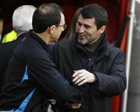 Sunderland's coach Keane greets Aston Villa's coach O'Neil ahead of their English Premier League soccer match in Sunderland