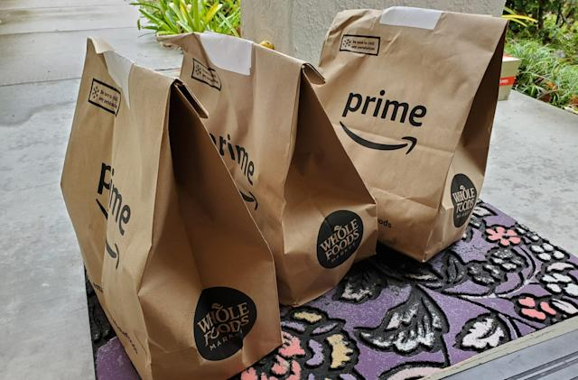 Amazon offers warehouse workers higher pay to handle Prime Now groceries