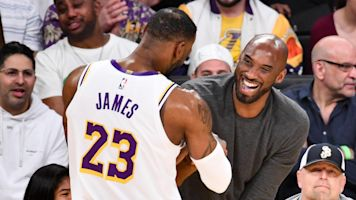Kobe watches courtside as LeBron dominates