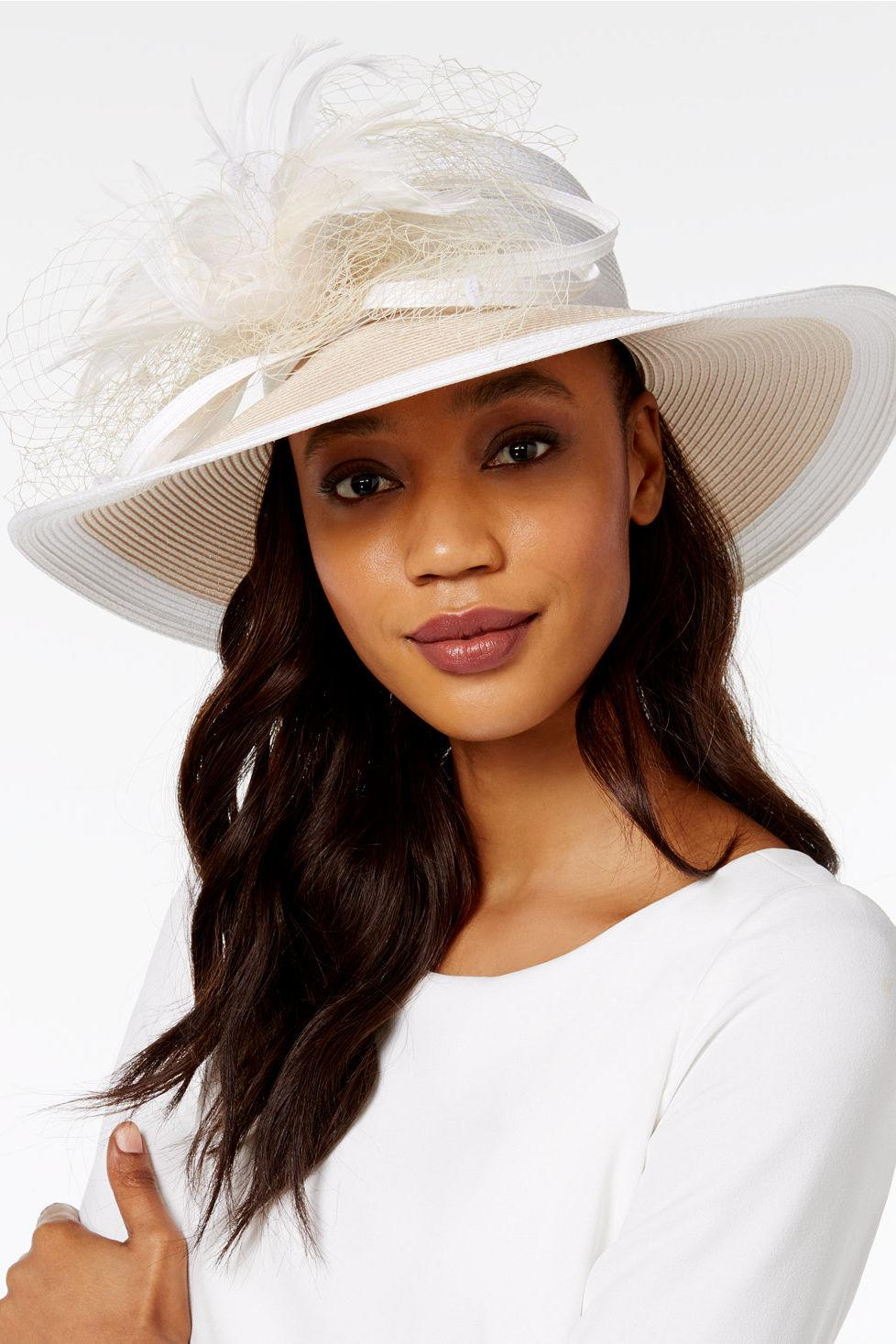 "<p><b>Buy it: $78, <a href=""https://www.macys.com/shop/product/august-hats-freesia-wide-brim-hat?ID=4373982&CategoryID=72347&selectedSize=#fn=sp%3D1%26spc%3D21%26ruleId%3D52%26slotId%3D19"" rel=""nofollow noopener"" target=""_blank"" data-ylk=""slk:macys.com"" class=""link rapid-noclick-resp"">macys.com</a></b></p> <p>We love the understated, two-tone color scheme of this church hat.</p>"